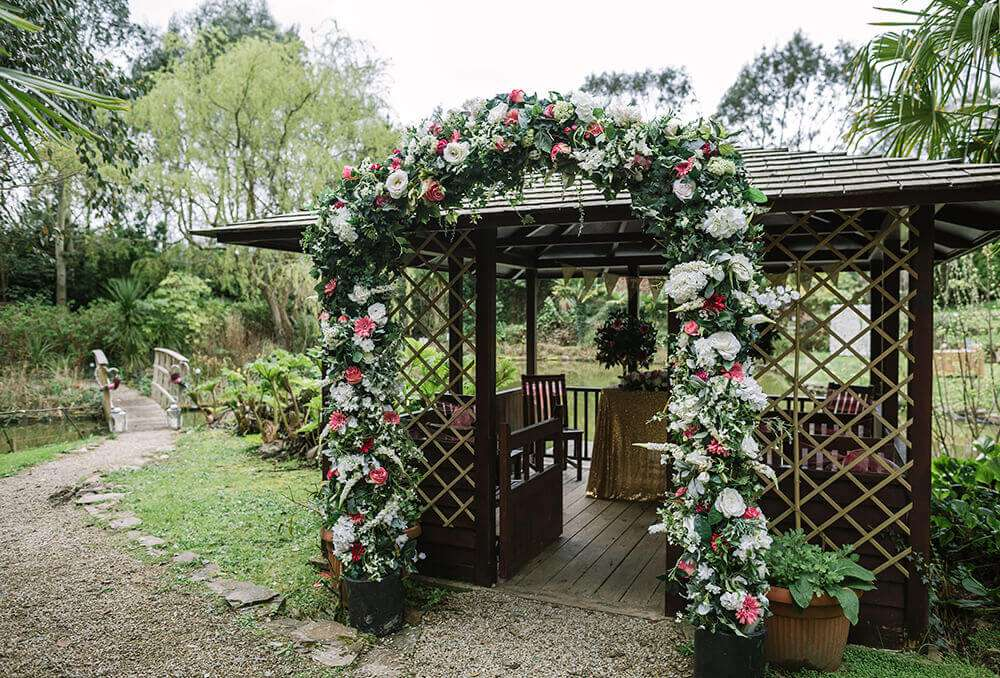 A Spring Wedding in Cornwall at The Emerald, photographed by Tracey Warbey Photography - Silk flower arch provided by With a Flourish