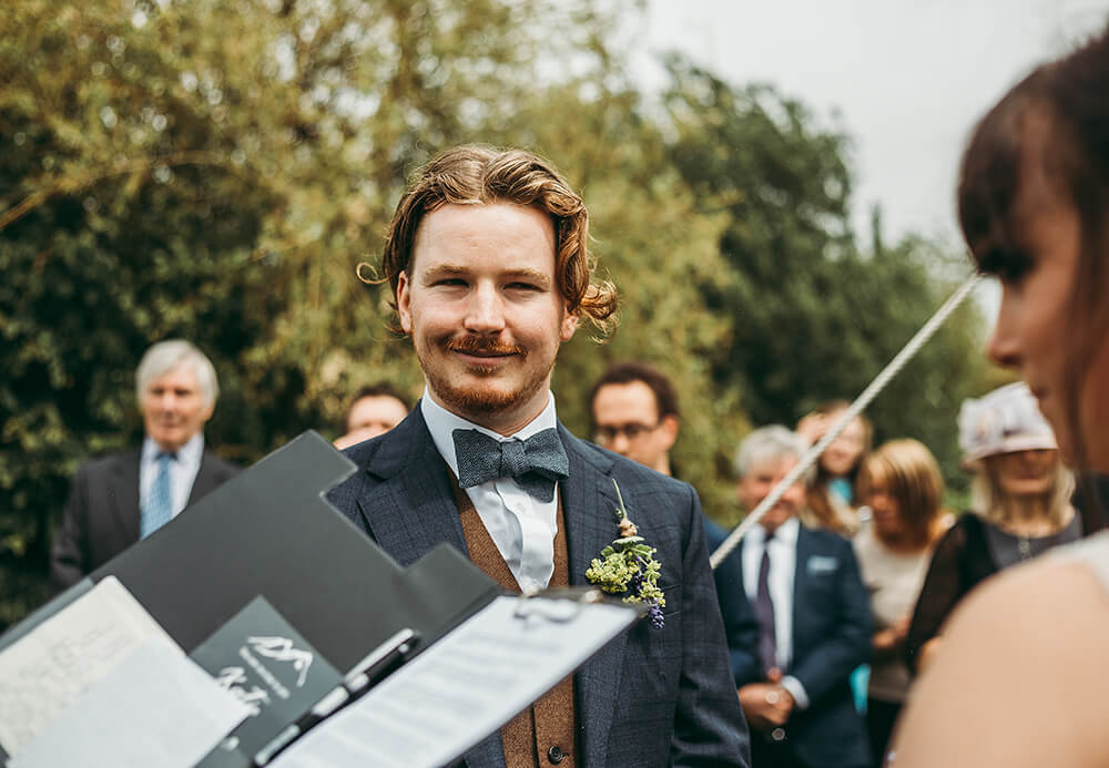 An English Country Tipi Wedding in North Cornwall Image 47 Groom smiling