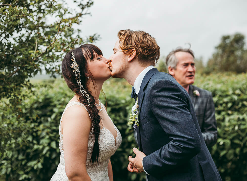 An English Country Tipi Wedding in North Cornwall Image 49 Sealed with a kiss