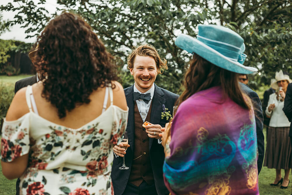An English Country Tipi Wedding in North Cornwall Image 56 Groom laughing