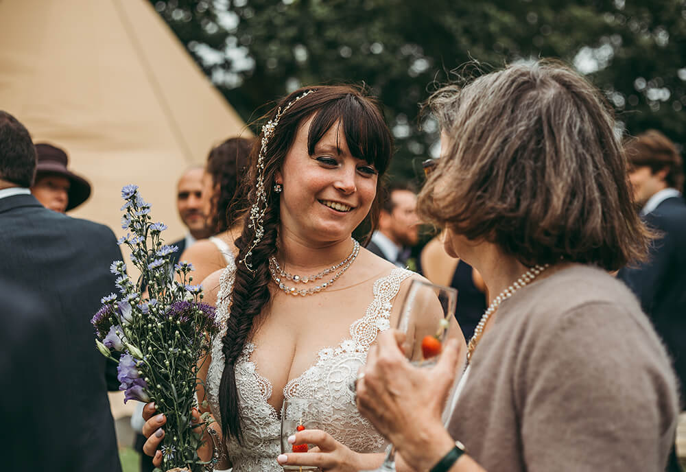 An English Country Tipi Wedding in North Cornwall Image 57 Bride candid