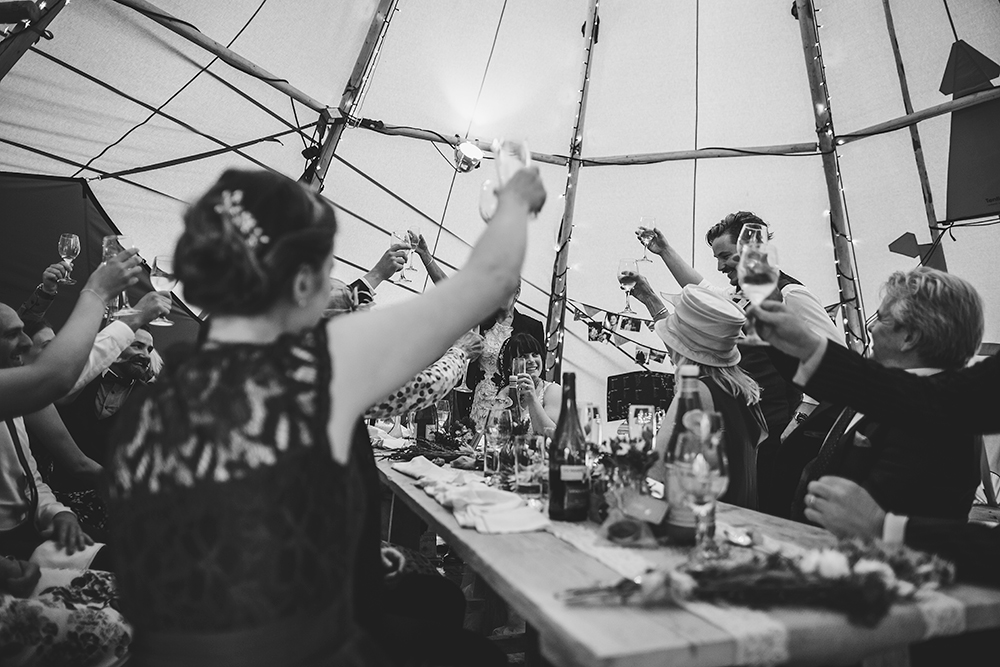 An English Country Tipi Wedding in North Cornwall Image 67 Raise a glass