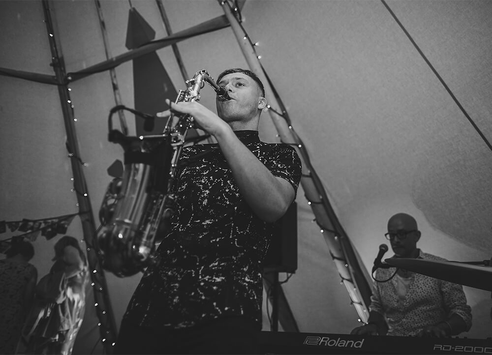 An English Country Tipi Wedding in North Cornwall Image 69 Saxophonist