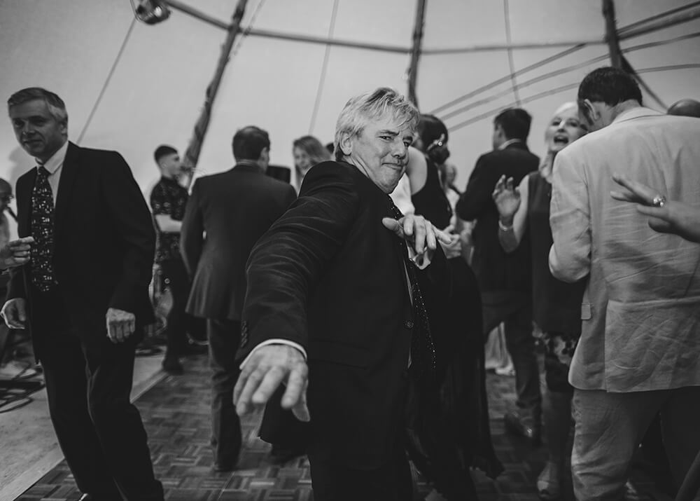 An English Country Tipi Wedding in North Cornwall Image 70 Grooms Father dancing