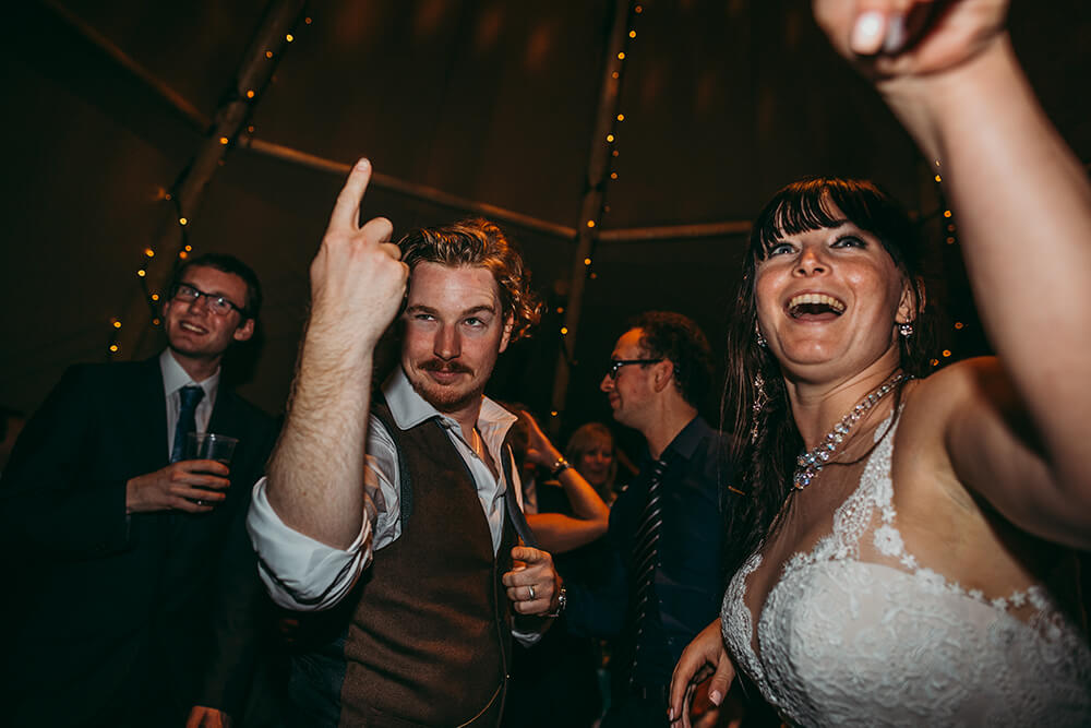 An English Country Tipi Wedding in North Cornwall Image 75 Bride and Groom dancing