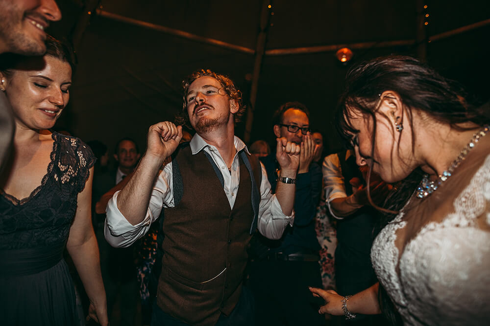 An English Country Tipi Wedding in North Cornwall Image 76 Groom dancing