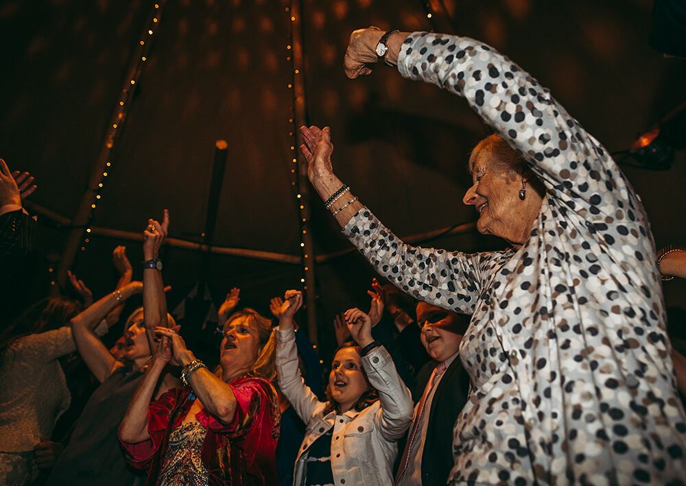 An English Country Tipi Wedding in North Cornwall Image 78 Grandma Rocks Out