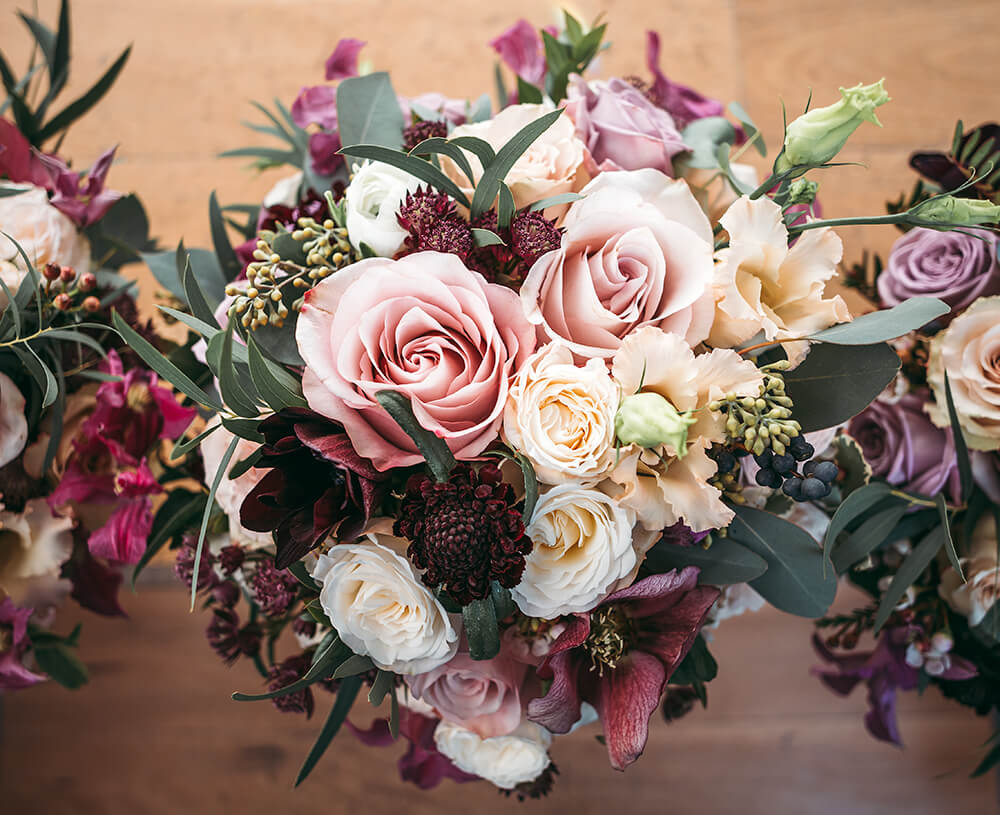A dusky pink bridal bouquet photographed by Tracey Warbey Photography