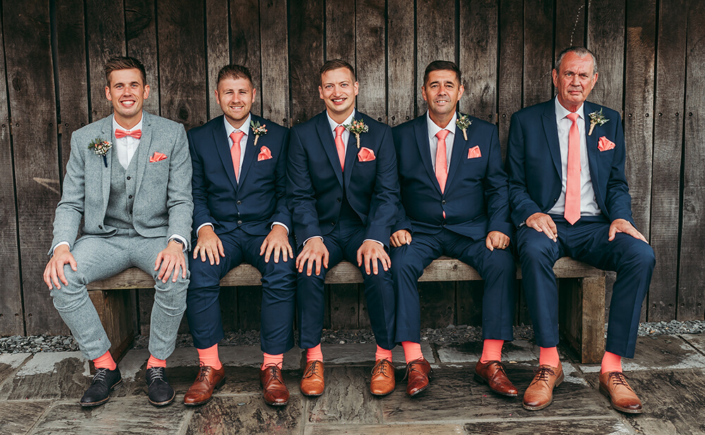 Brightly coloured socks for the groom's men at this Trevenna Barns summer wedding